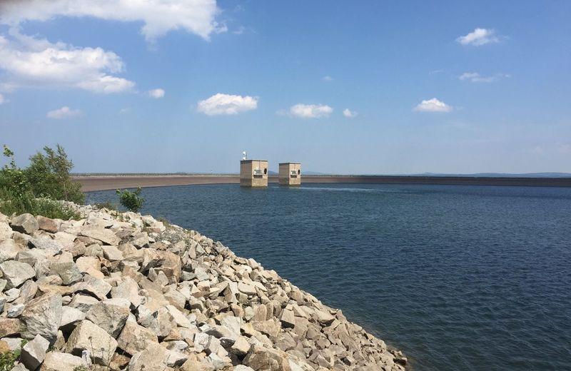 Reservoir against blue sky