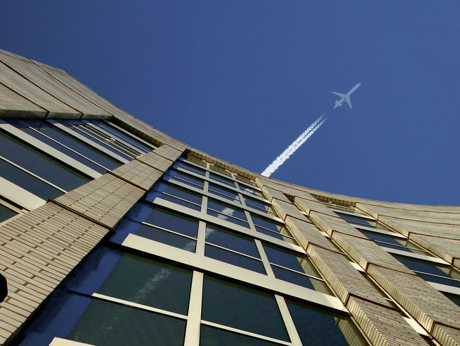 Architecture Built Structure Contrails Jet No People Outdoors Sky Windows