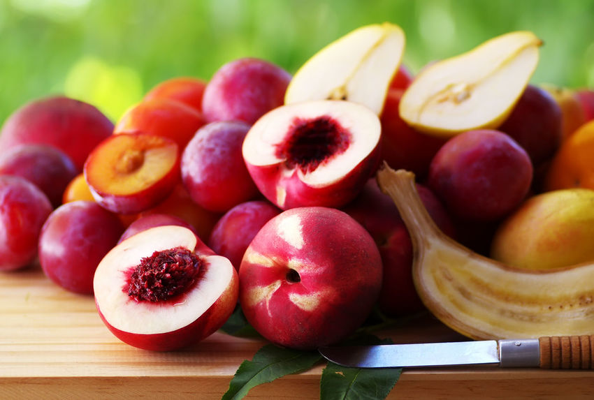 ripe nectarines and plums on table Nectarines Plums Close-up Food Food And Drink Freshness Fruit Healthy Eating Ripe Fruit Table Tablecloth