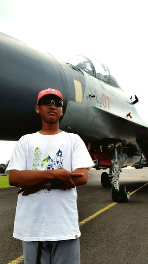 #indonesian_air_force #air_force_base #sukhoi Portrait Front View Confidence  Men Looking At Camera Sunglasses Sky Jet Engine Airplane Hangar
