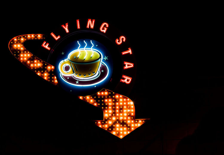 Have a cup of coffee at the Flying Star Black Background Close-up Electricity  Flying Star Neon Sign Glowing Iconic Route 66 Neon Sign Illuminated Lighting Equipment Neon Neon Arrow Neon Coffee Cup Night No People Orange Neon Outdoors Retro Neon