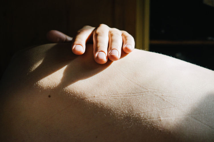 Close-up of woman hand with shadow