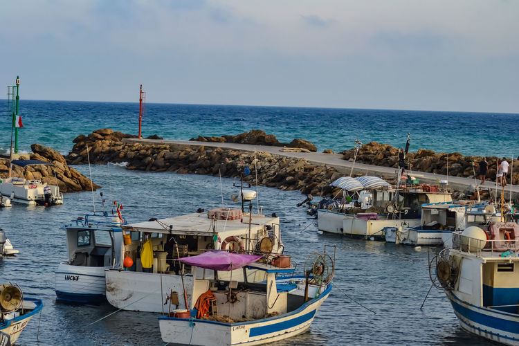 View of boats moored in sea
