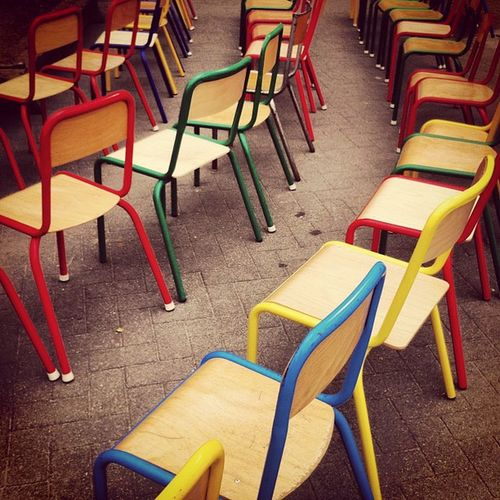 Row of multi colored empty chairs