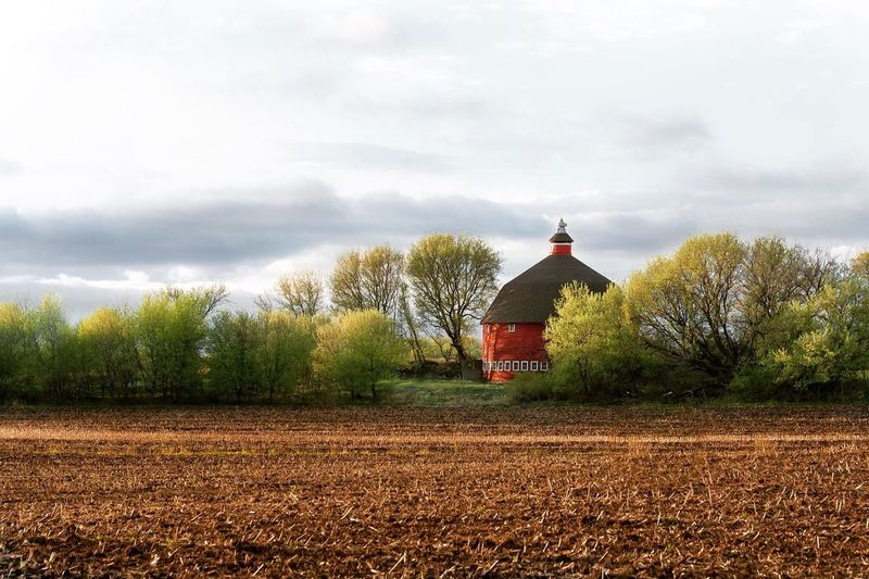The Last Light of Day Agriculture No People Springtime Spring Cloud - Sky Red Barn Round Barn Red Round Barn