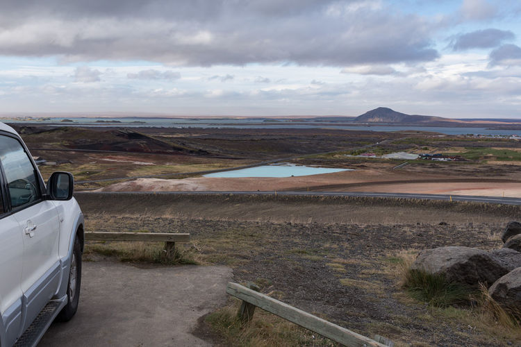 Lake Myvatn from the viewpoint, car included Our way to move around the Iceland. If you ever go there, take a 4x4. Hot Hverarönd Mars Myvatn Steam Boiling Empty Geothermal  Grey Hverir Mud Orange Color Otherworldly Puddle Road Trip Rotten Egg Stink Sulfur