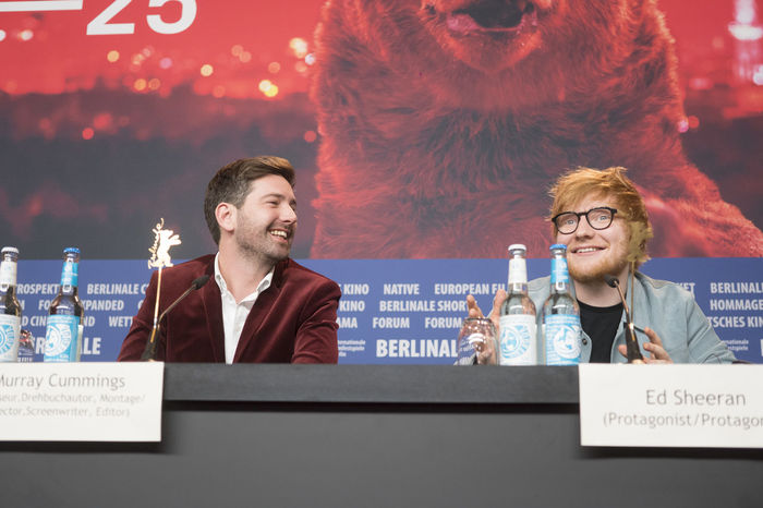 Berlin, Germany - February 23, 2018: English singer, songwriter, guitarist and record producer Ed Sheeran and director Murray Cummings attend the 'Songwriter' press conference at 68th Berlinale 2018 Artist Celebrity Ed Sheeran Ed Sheeran <3 Ed Sheraan❤ Famous Press Singer  Singer/Song Writer Berlinale Berlinale 2018 Berlinale Festival Berlinale2018 Berlinale68 Celebrities Famous People Front View Murray Cummings People Portrait Press Conference Singer And Artist Song Writer Two People Waist Up