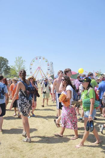 Event Adult Bonnaroo Casual Clothing Clear Sky Color Crowd Day Ferris Wheel Full Length Group Group Of People Large Group Of People Leisure Activity Men Nature Outdoors Pastel Colors Real People Sky Street Photographer Street Photography Sunlight Sunny Women