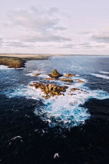 Pyramid Rock. (IG @noeldxng) Drone  Aerial View Aerial View From Above Landscape Sea Australia Victoria Phillip Island Vista Birds Eye View Outdoors Travel Destinations Wave Water Sea Sunset Beach Low Tide Astronomy Rock - Object Sky Horizon Over Water Rocky Coastline Rugged Volcanic Rock Volcanic Activity Coastline Seascape Coastal Feature Geology Surf Tide The Great Outdoors - 2019 EyeEm Awards The Traveler - 2019 EyeEm Awards
