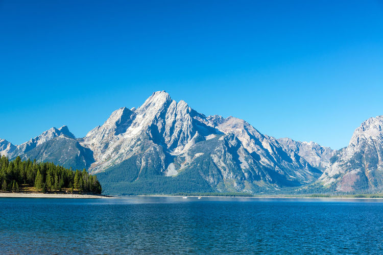 Teton Range and Jackson Lake view in Grand Teton National Park Alpine Bear Jackson Montana National Park Scenic Snake Tetons Travel Tundra USA Wyoming Destination Forest Grandtetonnationalpark Jackson Lake Landscape Lodge Mountain Overlook Peaks Range Valley Water Wilderness