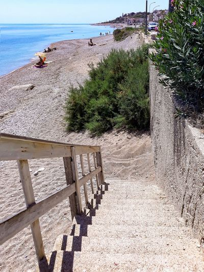 stairway to the beach Stairs stairways Beachphotography Beach Sea Water Land Sunlight Nature Day Plant High Angle View Horizon Over Water Scenics - Nature Beauty In Nature Tranquil Scene Outdoors
