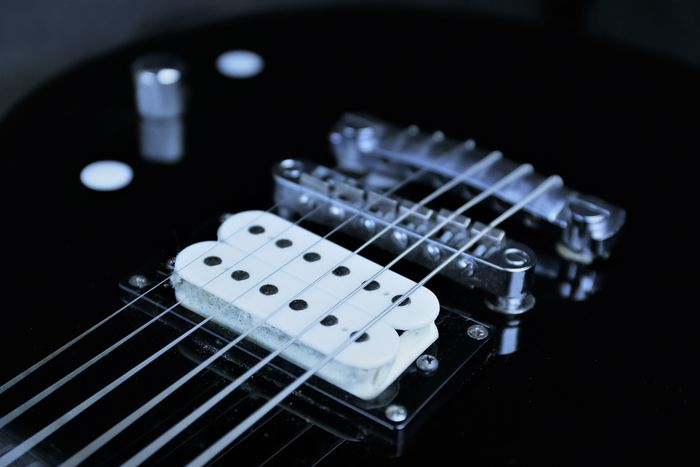 An Image of a electric guitar Audio Classic Dark Rock String Tune Chord Close-up Concert Electric Guitar Guitar Guitarist Instrument Music Musician Musik No People Pop Rock And Roll
