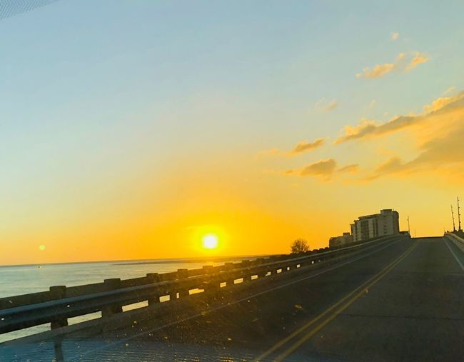 Bright bold sunset Beautiful Ft Myers Florida Beach Sunset Transportation Sky No People Sea Sun Scenics Nature Outdoors Water Road City Beauty In Nature Horizon Day Architecture
