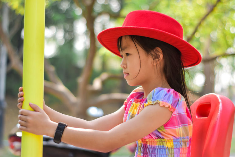 Close-up of girl wearing hat against blurred background