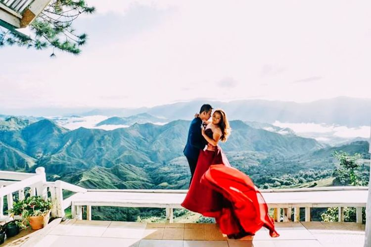 celebrating the love on top of the beautiful view of the hill EyeEm Selects Evening Gown Young Women Bride Beautiful People Women Beautiful Woman Portrait Togetherness Royal Person Females Falling In Love Romance Romantic Activity Engagement Oath Couple Wedding Vows Date Night - Romance Dating Newlywed Wedding Dress Queen - Royal Person
