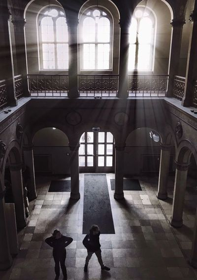 Ray Of Light Light Architecture Indoors  Window Real People Built Structure Day Men Lifestyles High Angle View Building Adult Arch