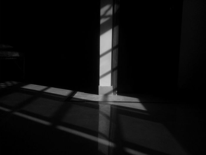Close-up of shadow on tiled floor