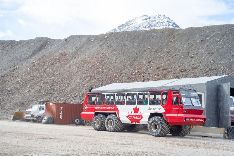 Vehicle on road against mountain range