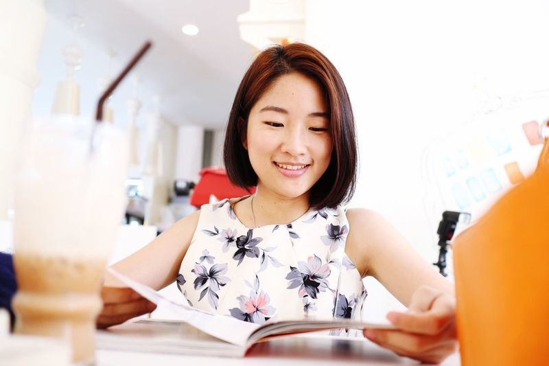EyeEm Selects Indoors  Women Smiling Portrait Happiness Modern Asian  Girl Portrait Relaxing Reading A Book Leisure Activity Coffee Time Cafe Mix Yourself A Good Time