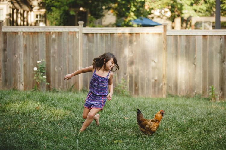 Full length of girl running on grass