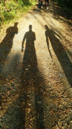 Day Field Focus On Shadow Ground High Angle View Leisure Activity Lifestyles Men Outdoors Park - Man Made Space Shadow Standing Sunlight