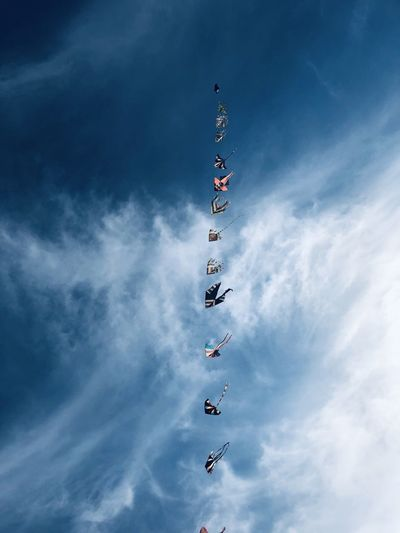Low angle view of kites against sky