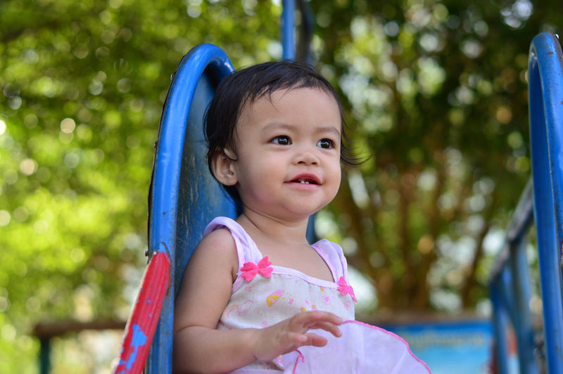 Asian baby girl smile Child Childhood Innocence Real People Girls Cute Focus On Foreground One Person Females Portrait Looking Looking Away Day Women Front View Holding Leisure Activity Baby Outdoors Asian  Smile