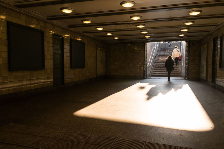 Rear view of women in illuminated subway