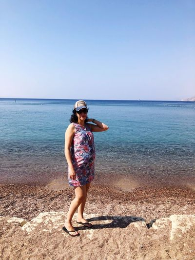 Standing Women One Woman Only Young Women Holiday Pregnancy Pregnant EyeEm Selects Water Beach Sea Land Sky Horizon Over Water Scenics - Nature Clear Sky Lifestyles Sunlight Leisure Activity One Person Beauty In Nature Horizon Real People Nature Day Outdoors