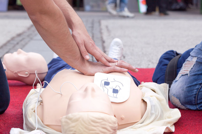First aid training. CPR. Defibrillation. CPR  First Aid Training Instructor Learning Life Paramedic Teaching Ambulance Staff Cardiac Massage Cpr Dummy Defibrillation Defibrillator Education Electrical Electrode Health Heart Help Human Hand Massaging Patient People Procedure