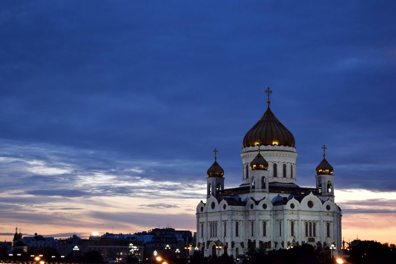 Illuminated cathedral of christ the saviour against cloudy sky during sunset