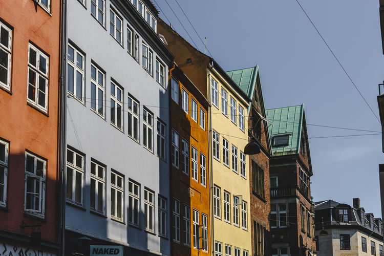 Copenhagen, Denmark Apartment Architecture Blue Building Building Exterior Built Structure Cable City Clear Sky Copenhagen Day Glass - Material In A Row Low Angle View Nature No People Outdoors Residential District Side By Side Sky Sunlight Window
