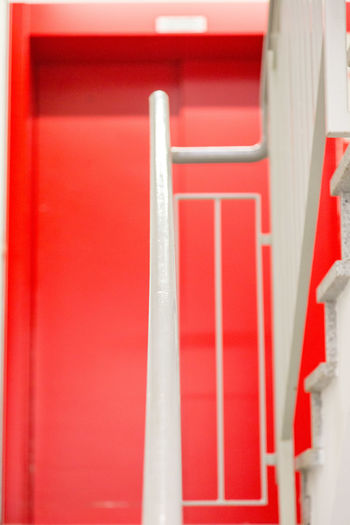 Red Backgrounds Full Frame Close-up Architecture Built Structure Building Painted Brick Wall Office Building Exterior Residential Structure Settlement Human Settlement Residential District Neighborhood Residential  Location Brick Building Exterior Residential Building Urban Fire Escape Archway Whitewashed Wall - Building Feature Closed Paint Historic Passageway