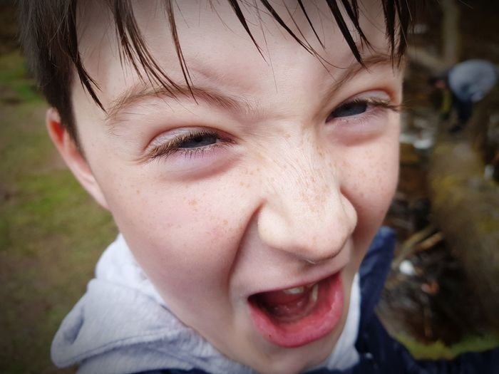 Close-Up Portrait Of Boy Screaming Outdoors
