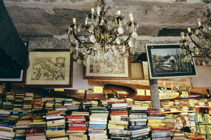 EyeEmNewHere 50mm Books CanonEos1200D Venezia Acqua Alta Art And Craft Book Can Collection Creativity Frame Indoors  Italy Large Group Of Objects No People Picture Frame Publication Shelf Still Life Variation Venice Vintage EyeEmNewHere