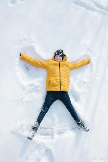 Man with umbrella on snowy field