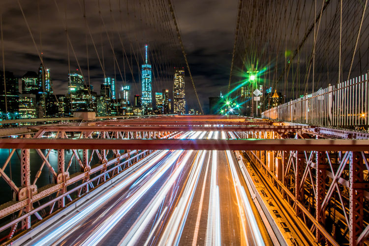 Light Trails On Brooklyn Bridge Against Sky At Night