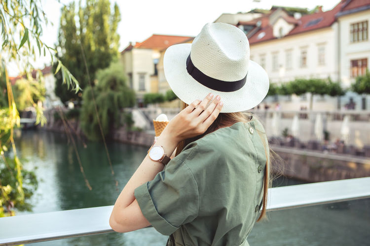 Close up portrait of Young woman city lifestyle with Watch on her wrist Hat Real People Water Lifestyles One Person Leisure Activity Clothing Women Day Adult Focus On Foreground Casual Clothing Standing Holding Nautical Vessel Nature Lake Transportation Outdoors Obscured Face Fashion Blogger Watch Urban Urbanphotography City Ljubljana Slovenia Portrait Portrait Of A Woman Woman Young Adult Young Women Casual Look