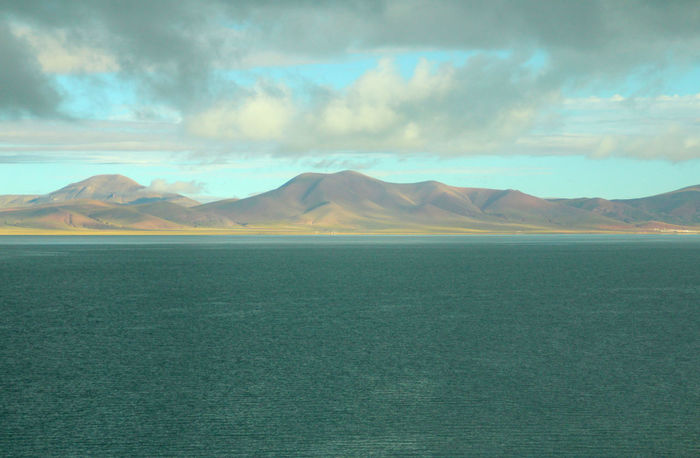 The scenery of Tibet from window of Qinghai Tibet Train (Lhasa Express), Tibet, China Arid Climate Beauty In Nature Cloud - Sky Clouds Day Lake View Landscape Mountain Nature Outdoors Scenics Sky Tibet Tranquil Scene Tranquility