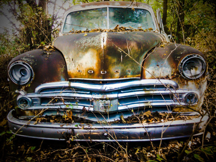 Forgotten Memories Lost In Nature Land Vehicle Rusty Car Abandoned Front View Damaged Headlight Grille Vintage Car Weathered Junkyard Run-down Obsolete Collector's Car Civilization Bumper First Eyeem Photo