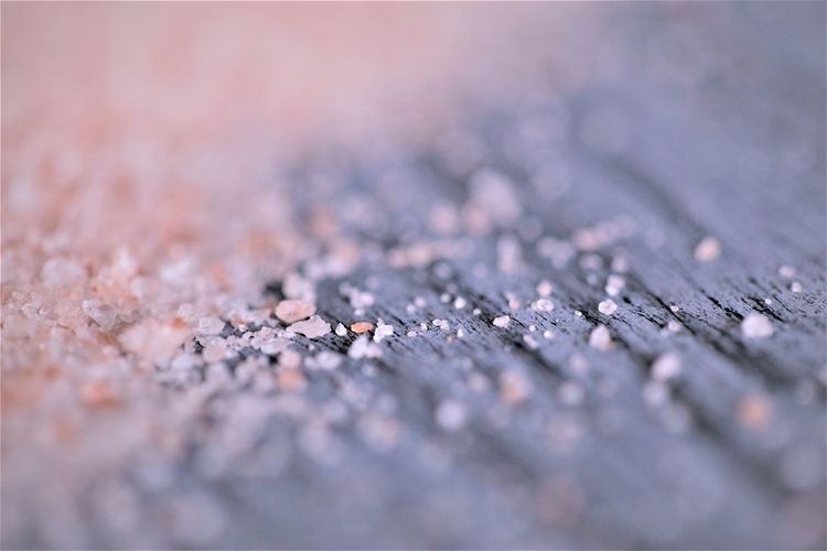 Close-up of salt on table