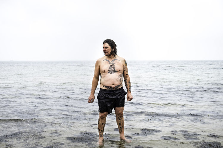 Beach Front View Full Length Horizon Over Water One Person Portrait Sea Shirtless Tattoo