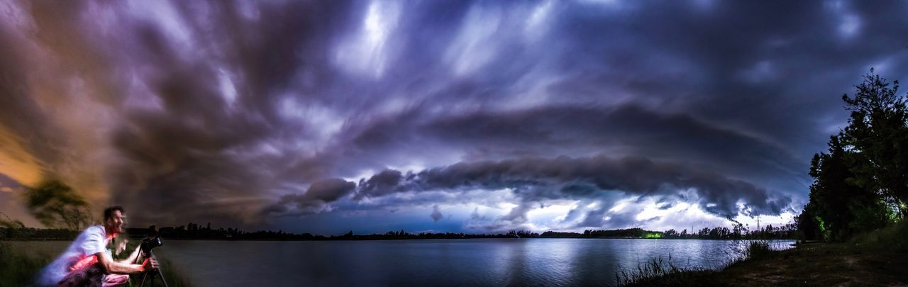 Panoramic view of storm clouds over lake at night