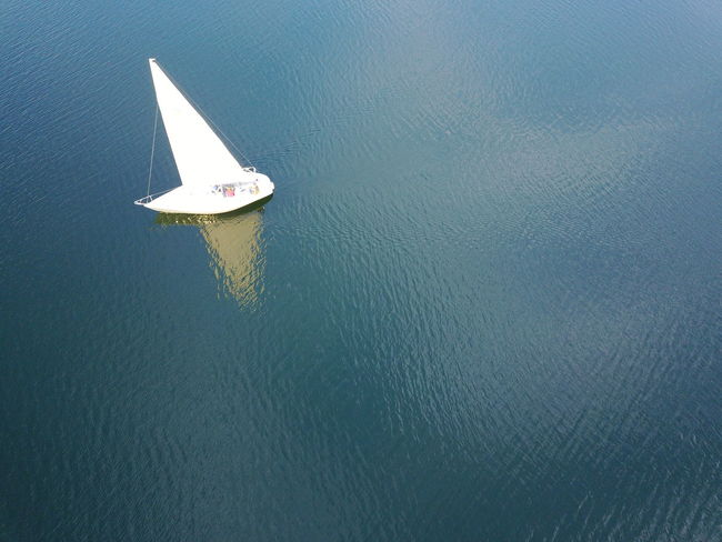 Reflection Beauty In Nature Boat Day High Angle View Mode Of Transport Nature Nautical Vessel No People Outdoors Sailing Sea Trakai Transportation Wake - Water Water Waterfront
