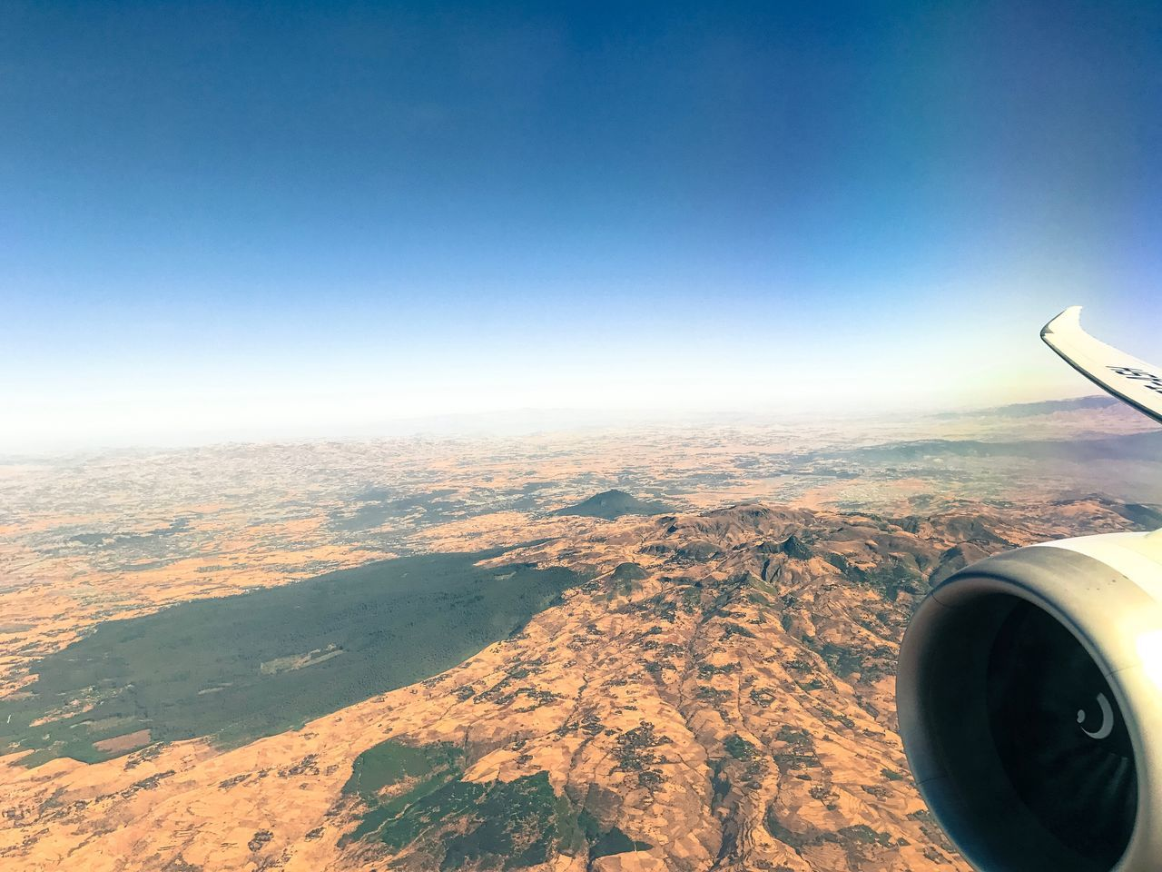 aerial view, airplane, transportation, journey, air vehicle, mode of transport, flying, travel, mid-air, aircraft wing, nature, airplane wing, jet engine, beauty in nature, scenics, day, outdoors, no people, landscape, vehicle part, sky