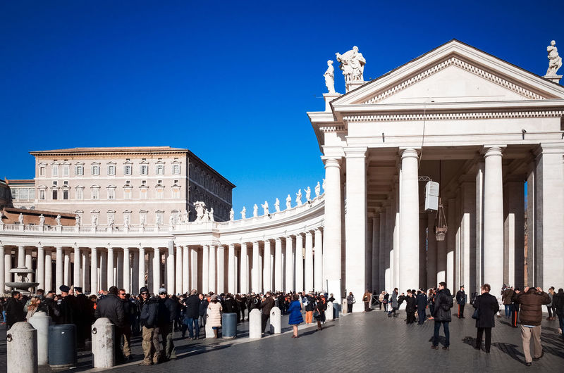 People At St Peters Square In City Against Clear Blue Sky