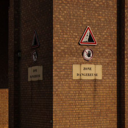 Architecture Brick Brick Wall Building Building Exterior Built Structure Communication Day Information No People Sign Text Wall Warning Sign