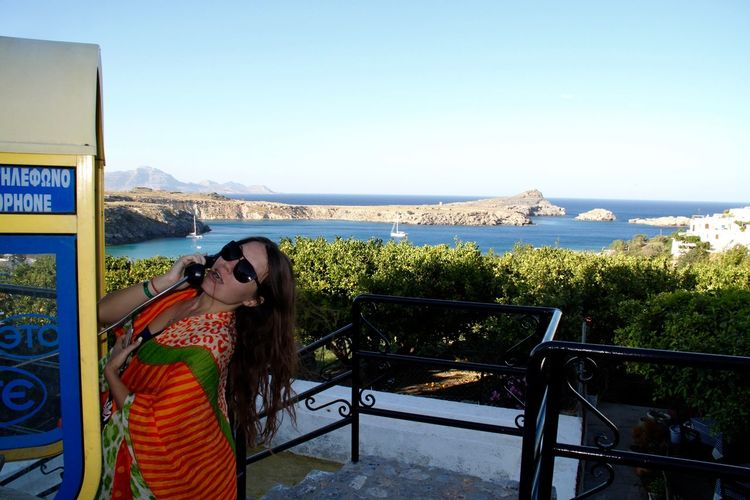 Fun Architecture Beauty In Nature Cityscape Day Horizon Over Water Lifestyles Lindos Mountain Nature One Person Outdoors Real People Rhodes Ródos Scenics Sea Telecommunications Equipment Telephone Telephone Booth Tourist Water Women Young Women Young Adult