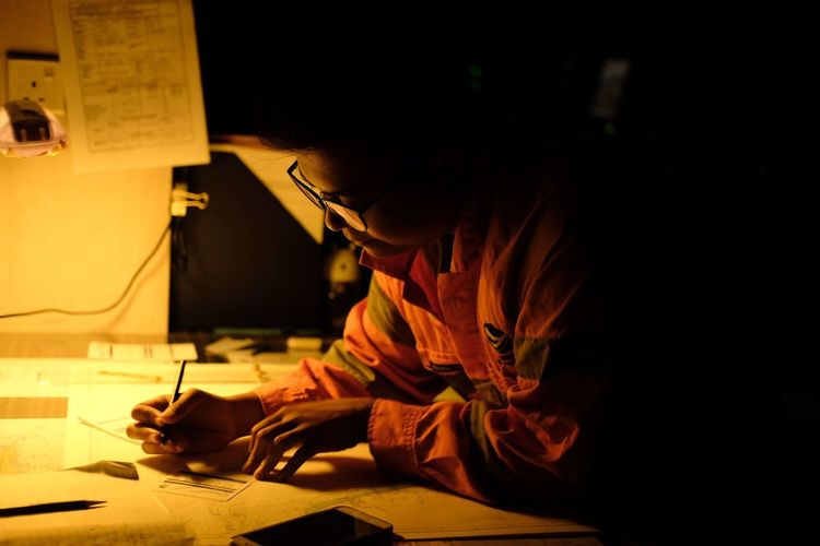 Architect working in office at night