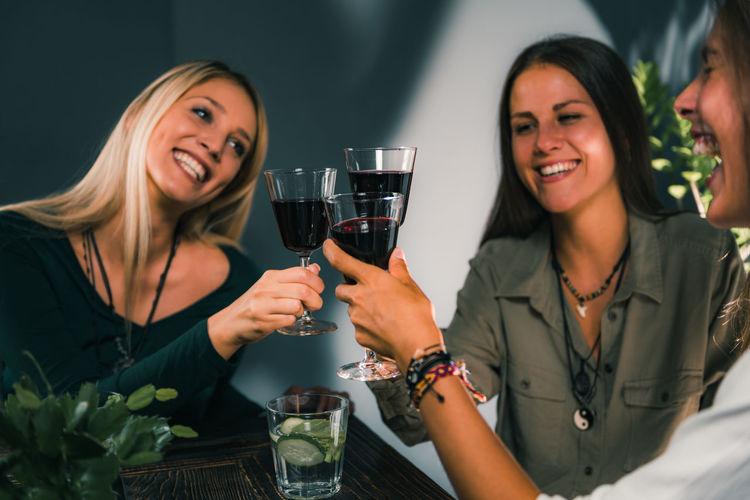 Female Friends Toasting Wineglasses In Restaurant